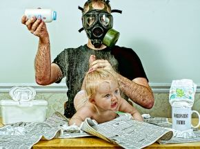 dad-wearing-gas-mask-while-changing-diaper