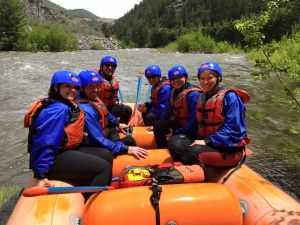 Jessica, Niki, and Michelle, Walk the Walk participants, have a blast rafting with their new found energy and time.
