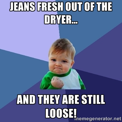 "Baby with fist raised in victory says ""jeans fresh out of the dryer... and they are still loose!"""