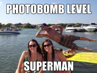 Girls in bikinis on the lake photobombed by a cute guy: Photobomb level superman!